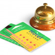 Reception bell and hotel cardkeys — Stock Photo
