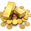 Gold ingots and coins — Stock Photo