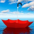 Stock Photo: Red floating umbrella in the sea