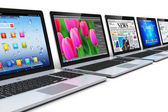 Row of laptops — Stockfoto