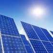 Stock Photo: Solar panels, blue sky and sun