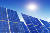 Solar panels, blue sky and sun — Stock Photo