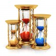 Vintage golden hourglasses — Stock Photo