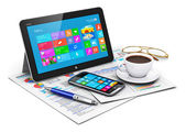 Tablet computer and business objects — Stockfoto