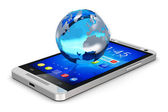 Earth globe on smartphone — Stockfoto