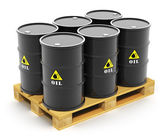 Oil barrels on shipping pallet — Stock Photo
