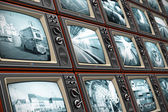 Wall of old TV screens — Stock Photo