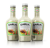Set of bottles with garlic dressing — Stock Photo