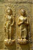 две золотые фигуры — Стоковое фото