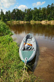 Kayak on the shore of river — Stock Photo