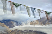 Buddhistic prayer flags in Himalayas — Stok fotoğraf