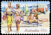 AUSTRALIA - CIRCA 2010 Surfers on Beach — Stock Photo