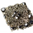 Black brooch - Stock Photo
