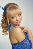 Blond woman with blue decorations — Stock Photo
