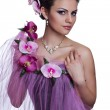 Brunette beautiful woman with flowers — Stock Photo