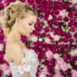 Bride on peony background — Stock Photo #27431039