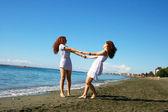 Women on beach — Stock Photo