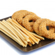 Round rusks and bread sticks — Stock Photo