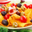 Stock Photo: Nachos, olives, pork loin and vegetables