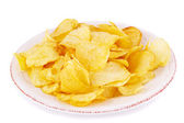 Potato chips on plate — Stock Photo