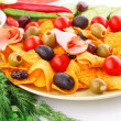 Nachos, olives, pork loin and vegetables — Stock Photo #34806237