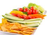 Nachos and vegetables — Stock Photo