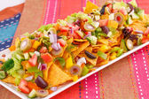 Nachos and vegetables — Stockfoto