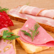 Sandwiches with salami, bacon and mortadella — Stock Photo