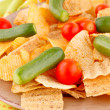 Potato chips and vegetables — Stock Photo