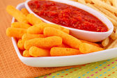 Potato, corn chips and red sauce — Stockfoto