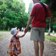 Young father and his little daughter walking — Stock Photo