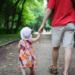 Young father and his little daughter walking — Stock Photo #12110203