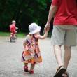 Young father and his little daughter walking — Stock Photo #12110208