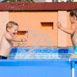 Two boys splashing — Stock Photo #12255777