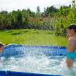 Two boys splashing — Stock Photo #12255793