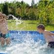 Two boys splashing — Stock Photo