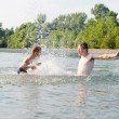 Stock Photo: Young father and son swimming in river