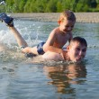 Royalty-Free Stock Photo: Young father and son swimming in river