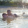 Young father and son swimming in river — Stock Photo #12255813