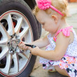 Lillte child playing in auto mechanic — Stock Photo #12255882
