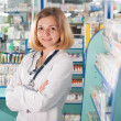 Stock Photo: Young pharmcist in drugstore