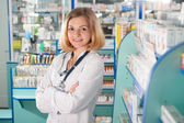 Young pharmcist in drugstore — Stock Photo