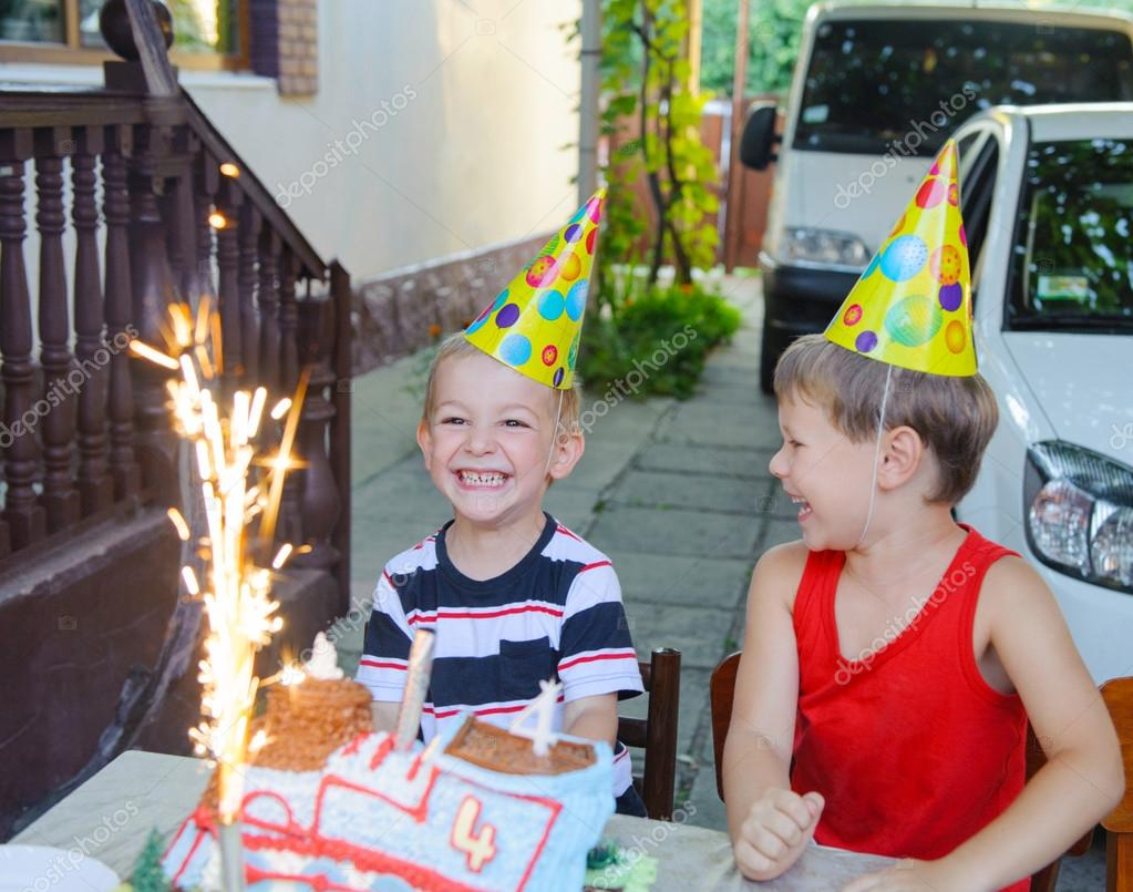 Outdoors birthday party with cake and fireworks candles — Stock Photo #12546495