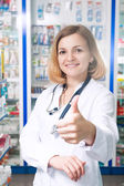 Thumb up druggist — Stock Photo