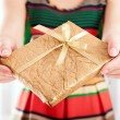 Christmas present in golden wrap — Stock Photo