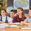 Royalty-Free Stock Photo: Four pupils in classroom