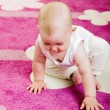 Baby on carpet — Stock Photo #13856257