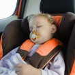 Toddler girl sleeping in baby car seat — Stock Photo