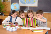Elementary pupils in classroom — Stock Photo