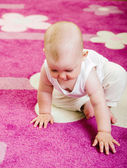 Baby on carpet — Stock Photo